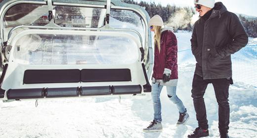 A piedi in quota con la seggiovia sulla ski area Mottolino a Livigno